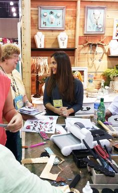 Jen Long, Sizzix Creative Director and artist, attended the 16th Annual Bead and Button Show. Here Jen is discussing with individuals about using new Jill MacKay Jewelry Making Dies. It's such a pleasure getting to talk to people about the things they are most passionate about!