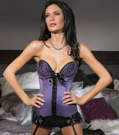 Lilac  Lace Bustier This sexy Lilac  Lace Bustier is a one-piece satin bustier with dot mesh over satin padded underwire cups, soft boning, and scalloped lace paneling. Also, includes center back lace up design, center front hook  eye closure, two accent bows at the hem, removable center front bow with rhinestone detail. This bustier features removable straps and 6 removable garters. Also Available in Plus Size. $72