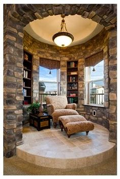 Now, HERE is the perfect reading nook. Like the chair, the shelves, the windows, the walls! Pipe in some calming music, and I'm good!