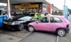$275,000 Aston Martin DBS Totaled By Bright Pink Hatchback