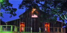 A nighttime shot of the back of the barn | Heritage House Dripping Springs | By: Red Fly Photography