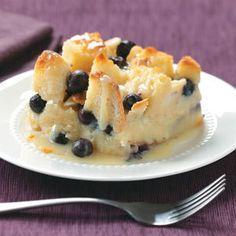 Over-the-Top Blueberry Bread Pudding. Lots of white chocolate sauce here. With blueberries and white chocolate glaze, this would look pretty scooped into my antique pink glass parfait 'glasses.'