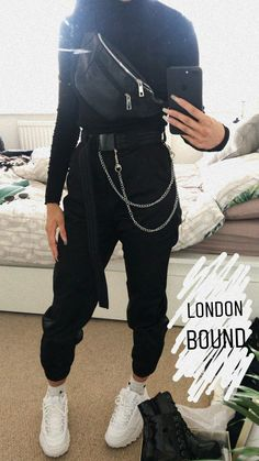 black turtleneck + black leather waist bag (worn as cross body) + black pants + white sneakers