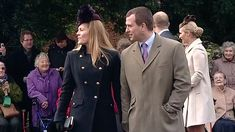 The Queen's grandson Peter Phillips walks hand-in-hand with his wife Autumn Kelly.