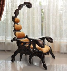 Creepy...but cool.  This is a perfect chair for a villain's home.