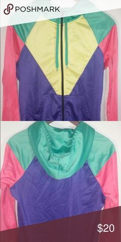 Retro bright color jacket This jacket is an eye catcher. The bright colors give it that very 90's look that is very popular these days. It has a very comfortable fit and goes great with a white tank top, fitted jeans and some neutral colored shoes. The pockets make carrying extra items easy while looking very fashionable. This piece is a must have for anyone who appreciates 90's fashion. When wearing this you will stand out from the rest which is what fashion is all about. Along with that…
