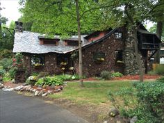Stone brick & slate Storybook style home in Springfield MA. Built by Native American Wo Peen with Native American artwork on exterior .