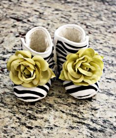 Boutique Zebra Baby Booties with Couture Moss Green flower Size Newborn- 1 year Baby shower gift. $19.99, via Etsy.