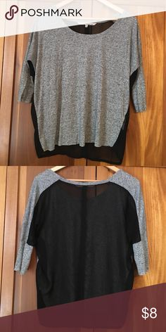 Rachael Roy top Loose lightweight 3/4 sleeve top with sheer black back. Tag on inside hip was cut off because it was visible through the sheer back. Otherwise in great condition RACHEL Rachel Roy Tops Blouses