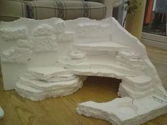 DIY cave habitat for bearded dragon cage carved from foam.