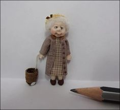 48th Scale Old Dear Doll with her Basket on Wheels
