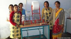 The sanitary pad revolution in rural India. Indian school girls stand before the sanitary pad machine