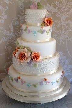 pastel flower and bunting wedding cake