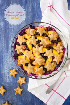 Brown Sugar Blueberry-Peach Cobbler - A juicy mixture of seasonal fruit sweetened with brown sugar and topped with flaky, buttery, pie crust stars for a patriotic twist. | www.brighteyedbalker.com
