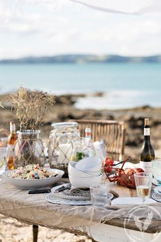 Relaxed setting with Rope lanterns, beaded pearl dinnerware and rattan placemats www.frenchcountry.co.nz Beach Cottages, Summer 2015, Rattan, Dinnerware, Lanterns, Beach House, Table Settings, Pearl, Photography