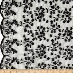 Telio Daisy Embroidery Black from @fabricdotcom  Delicate and classic, this sheer lace features an embroidered floral design and scalloped edges. This beautiful lace also has stiff feel for a more structured look. This lace fabric is appropriate for overlays on skirts or dresses, feminine apparel accents and wraps or shrugs.
