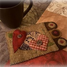 """""""Luv Rug"""" mug rug pattern is now published on my website. #wool #woolapplique #mugrug #heart #handmade #handcrafted #love #candlemat #pennies #vintagelace"""