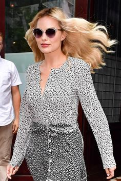 Margot Robbie schools us in the art of working every inch of a bombshell head of hair.