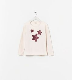 Image 1 of T-SHIRT WITH APPLIQUÉS from Zara