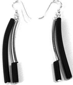 These drop-earrings can be worn for any occasion.  The hooks are sterling silver and the drop is made of black rubber with silver plated tubes, making them very comfortable and light to wear.