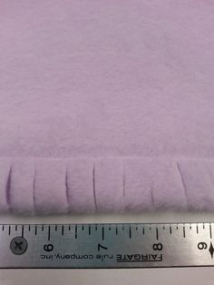 """This is a fun way to finish the edge of a simple fleece blanket that is similar to a """"tie-blanket""""more sophisticated look. For this project you will need: 1 yards of a fleece material, I used lavender fleece scissors sewing machine and thread and Braided Fleece Blanket Tutorial, Fleece Blanket Edging, No Sew Blankets, Polar Fleece Blankets, Fleece Crafts, Fleece Projects, Sewing Projects, Sewing Ideas, Sewing Tips"""
