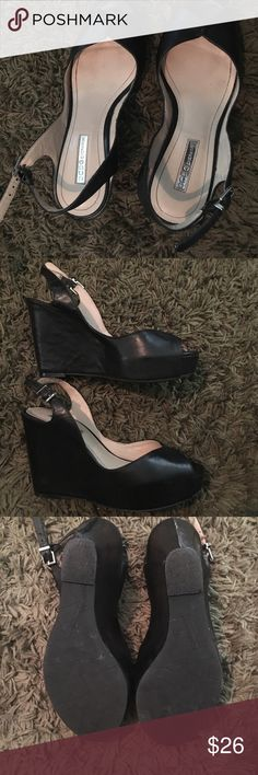 Black BCBG sandals (leather) Worn two or three times. Excellent condition. 4 inch platform heels. Very comfortable.  This is a steal!  Paid original price for them. BCBGeneration Shoes Platforms