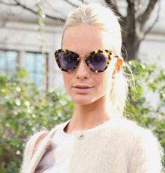 Poppy Delevigne - London. Wearing Miu Miu sunglasses. Photo cred: The i on Fashion