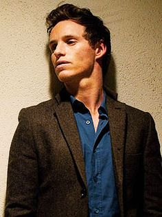 Eddie Redmayne - Exhibit Z - leaning against a wall - Hot. Look at that jawline.