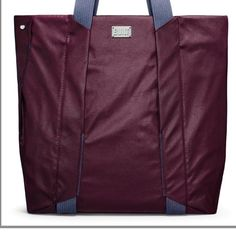 """Built NY everyday work tote rafted from water-repellent poly canvas to help shield your items from the elements. The Essential Work Tote offers a plethora of the most convenient features including: Cushioned compartment with fastening devices to secure a laptop up to 16-inches, three-pocket organizer, discreet front zip pocket, snap closure, removable shoulder strap, the list goes on. There's even a padded interior pocket for iPad, tablet, e-reader or files. Dimensions: 17""""x 19""""x4.7""""…"""