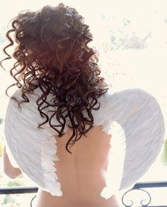 Curly hair, wings