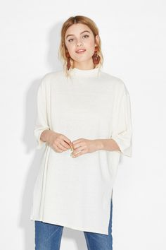This awesomely oversize polo neck top wants two things: to go big and to go home with you!