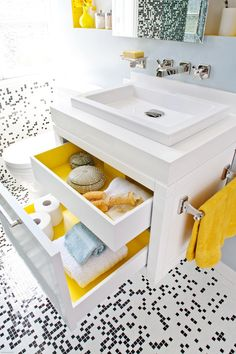 A white Duravit vanity with the two drawers open. The inside of the drawers are painted yellow.