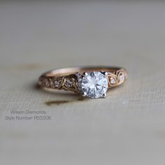Beautiful leaf motif with vines and inset pave diamonds in this vintage engagement ring!! #rosegold #wilsondiamonds