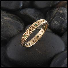 Celtic knotwork wedding band with gemstones.                                                                                                                                                                                 Más