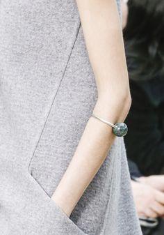 Angular pocket dress and sphere bracelet