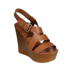 """Platform wedge sandal with criss-cross straps and adjustable slingback ankle strap. Platform is 2"""" and heel is 5"""" tall. Fits true to size."""