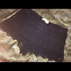 Navy Hollister lace shorts Lace Hollister shorts, they're stretch so they're very comfy yet very cute because come on now, it's lace! (: size L so it's about a 30/31. The color is navy blue. Never worn! Hollister Shorts