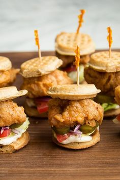 This quick and easy 30-minute chicken and waffles recipe incorporates mini waffles, mayonnaise, lettuce, sliced tomato, onion and pickles to create the ultimate Southern comfort food recipe. Whether you're looking to eat these sliders for a quick and easy weekday breakfast or use them as a holiday brunch recipe, it's a great choice for a waffle recipe.#wafflerecipes #chickenandwaffles #southernrecipes