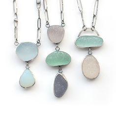 Three pastel sea glass pendants with hand made chains by Tania Covo