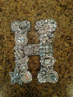 Initial out of old jewelry- Walk in closet or little girls room.... Too Cute:)