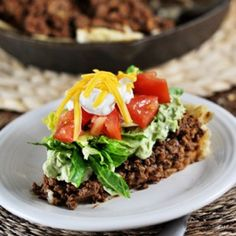 Skillet Taco Pie - Topped with a refried bean mixture bumped up a notch with some simple spices and then topped again by seasoned ground beef or turkey – the pie is made even more luxurious with an avocado/cream cheese/garlic blend that nearly knocks it right out of the park.