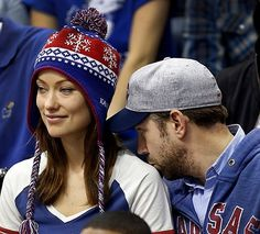 Olivia Wilde and Jason Sudeikis at a KU game. Rock Chalk!! It makes me love Olivia Wilde even more!!!