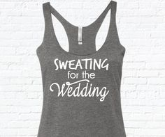 Sweating For The Wedding printed on a triblend, racerback tank top. These tanks are a mix of cotton and poly, making them super soft and light. This is a relaxed-fit tank that runs true to size (women