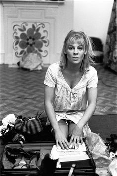 Julie Christie packing her suitcase to travel for filming Dr Zhivago, (Photo by Michael Ward/Getty Images) Julie Christie, Nylons, Vintage Glamour, Vintage Lingerie, Film Doctors, Marilyn Monroe Poster, Dr Zhivago, Stocking Tops, Anos 60