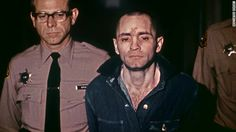Manson is led, head shaved and beardless, to hear his sentence on ...
