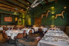 Lion Noir Restaurant and Bar in Amsterdam is a hip place to dine & drink. Lion Noir Restaurant offers French food in a stylish setting. Amsterdam Restaurant, Restaurant Offers, Amsterdam City Centre, Fresh Shop, Cities In Europe, Cool Bars, Table, Lion, Cafes