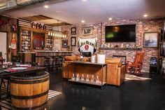 Gallery | BRICK-IT like the track light made of old bttles like the metal strip (like whiskey barrel) holding bar together This could be the Front bar, where bar stools would be located