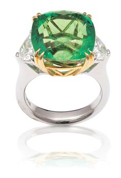 AN IMPRESSIVE COLOMBIAN EMERALD AND DIAMOND RING.