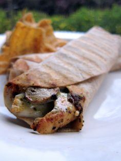 Plain Chicken: Chicken Pesto Wraps  For this wrap, we grilled some chicken tenders that had been marinating in Italian dressing and pesto.  You can use some of the precooked Italian chicken strips if you don't want to grill the chicken yourself.  We loved the flavors in this wrap.  The pesto added great flavor without being overpowering.