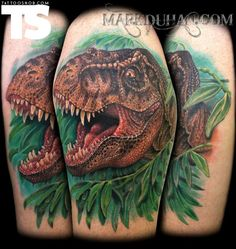 OMG, I love dinosaur tatts so much. Not sure why, but this is a sick tattoo by Mark Duhan at Skin Deep Ink in New Milford, Connecticut